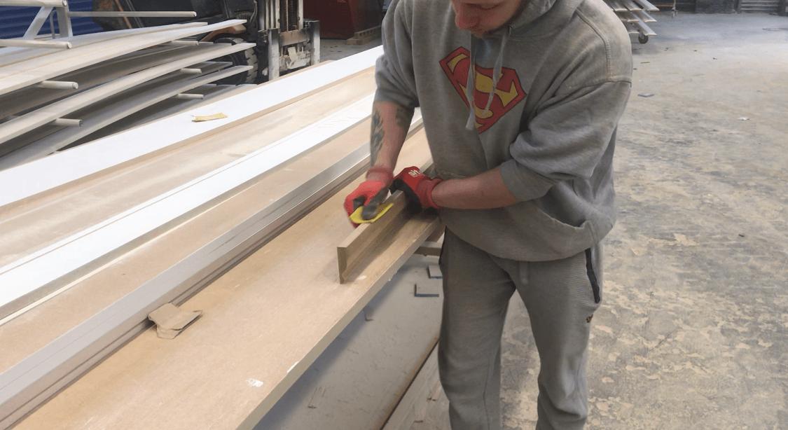 Sanding the skirting board made